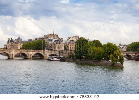 Cite Island and Pont Neuf the oldest stone bridge across the Seine river in Paris France poster