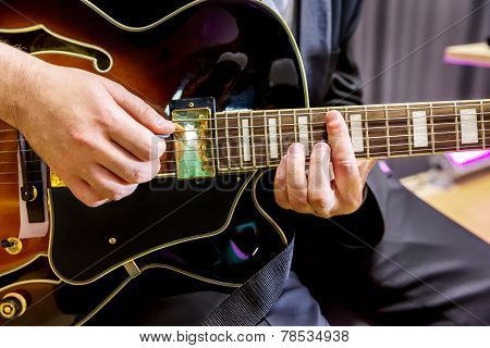 Guitarist Playing In Jazz Band