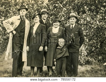 GERMANY, CIRCA 1930s- vintage photo of family in garden
