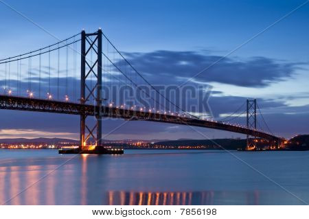 The Forth Road Bridge at twilight, just after sunset. Opened in 1964 and adjacent to the historic Forth Railway Bridge, this suspension bridge links Edinburgh at South Queensferry to Fife, at North Queensferry. poster