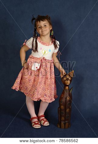 portrait of cute little girl on blue background