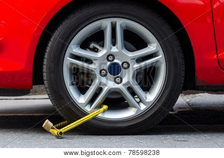 Clamped Wheel Of Illegally Parked Car