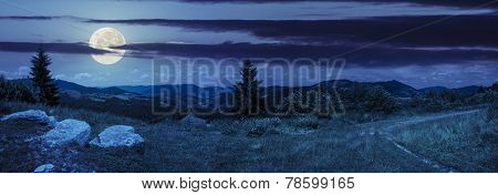 Boulders On Hillside Meadow In Mountain At Night
