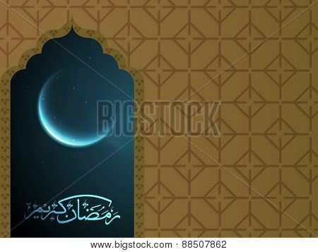 Arabic calligraphy text Ramazan Kareem (Ramadan Kareem) with view of shiny crescent moon in blue night from window for islamic holy month of prayer celebration.