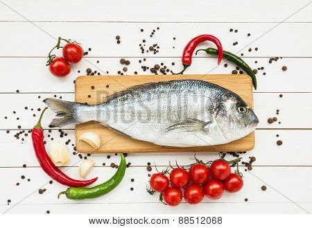 Fresh dorado fish on wooden cutting board