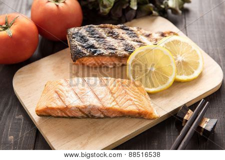 Grilled Salmon On Cutting Board On Wooden Background.