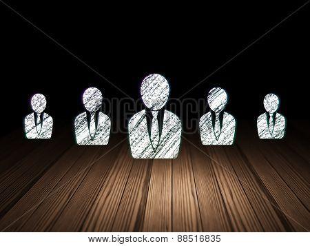 Finance concept:  business man icon in grunge dark room
