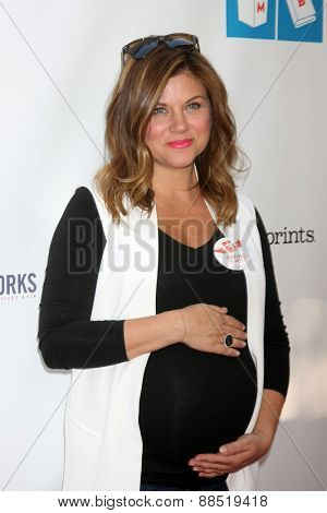 LOS ANGELES - FEB 19:  Tiffani Thiessen at the Milk+Bookies Sixth Annual Story Time Celebration at the Toyota Grand Prix Racecourse on April 19, 2015 in Long Beach, CA