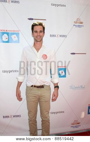 LOS ANGELES - FEB 19:  David Walton at the Milk+Bookies Sixth Annual Story Time Celebration at the Toyota Grand Prix Racecourse on April 19, 2015 in Long Beach, CA