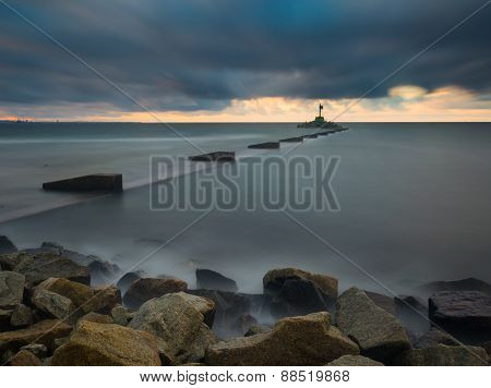 Mouth of the river Vistula in Gdansk. Long exposure seascape. Beautiful rocky breakwater on sea shore and protection walls on mouth of river. poster