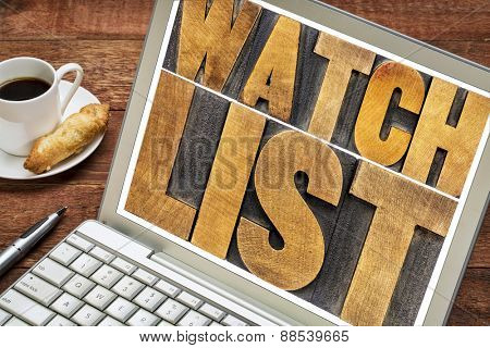 watchlist word abstract typography - text in letterpress wood type on a laptop screen