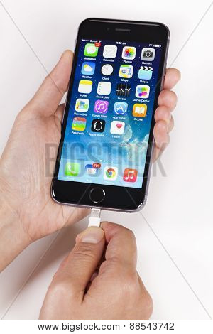 Plugging lightning cable into an iPhone