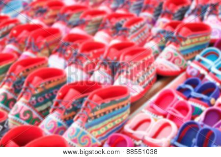 Blurry Defocused Colorful Handmade Fabric Kid Shoe Of Thailand Tribesman For Background.