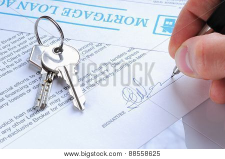 Client Signing A Mortgage Loan Agreement
