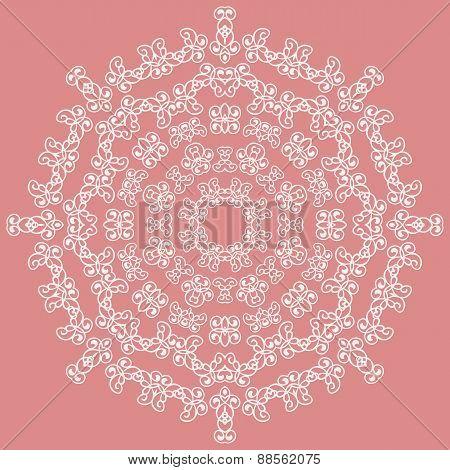 Round white ornate pattern on pink background