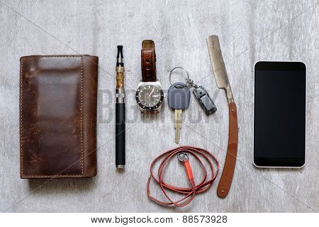 Men's Accessories , Top View On A Wooden Wallet The Phone Purse, Razor And E-cigarette