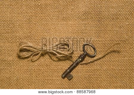Key And A Coil Of Rope On The Old Cloth