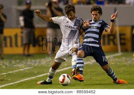 CARSON, CA. - APR 18: Benny Feilhaber & Baggio Husidic (L) in action during the L.A. Galaxy game against Sporting Kansas City on April 18, 2015 at the StubHub Center in Carson, California.