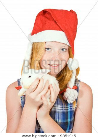 Teen girl in santa hat with rabbit isolated on white background poster