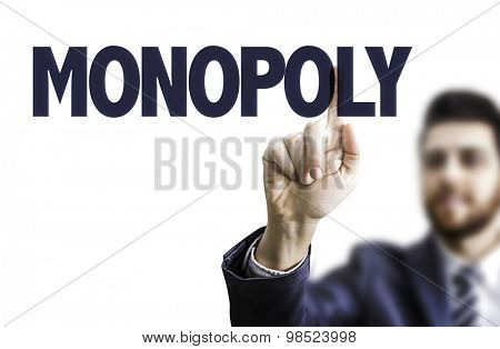 Business man pointing the text: Monopoly