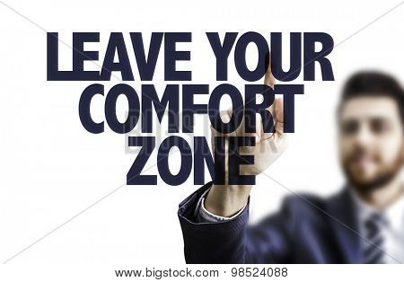 Business man pointing the text: Leave Your Comfort Zone