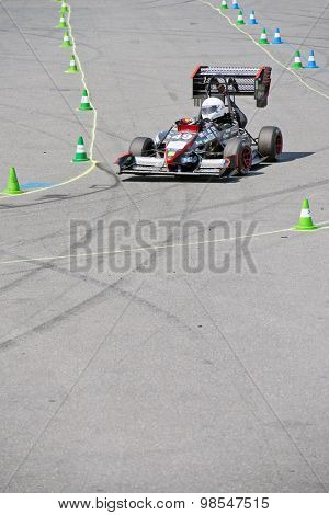 HOCKENHEIM, GERMANY - AUGUST 1, 2015: Unique designs of  race cars during the world championships of the formula student design competition during the dynamic endurance on the hockenheimring circuit.