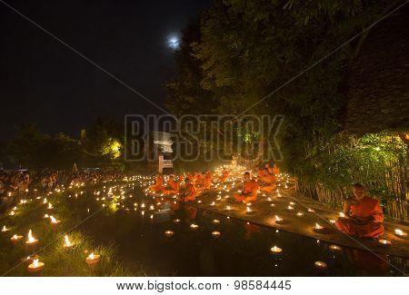 Chiang Mai, Thailand - July 30: Unidentified Thai Monks Meditate Around Buddha Statue Among Many Can