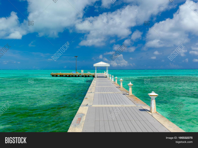 Pier On Caribbean Sea Image & Photo (Free Trial)   Bigstock Caribbean Sea Cayman Islands on nassau caribbean, saint-martin caribbean, belize caribbean, cooper island caribbean, caicos caribbean, pennsylvania caribbean, windward islands caribbean, el salvador caribbean, eustatius caribbean, union island caribbean, monaco caribbean, anegada caribbean, virgin islands caribbean, guam caribbean, dominica island caribbean, jamaica caribbean, peter island caribbean, guatemala caribbean, chile caribbean, st barts caribbean,