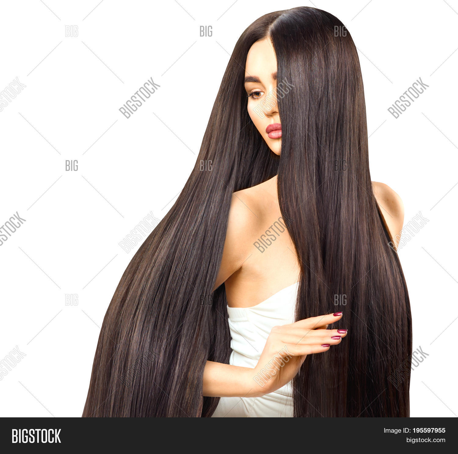 Beautiful long Hair. Beauty woman with luxurious straight brown hair  isolated on white background.
