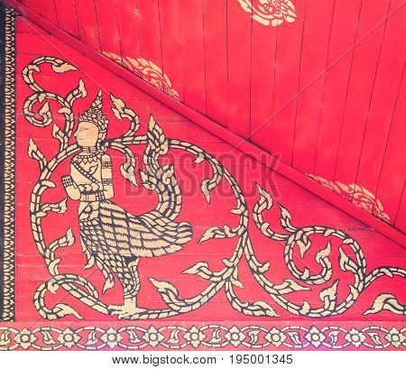 Golden paintings of the fairytale animals on the wooden ceilingThai church.(Public area not required Property Release)
