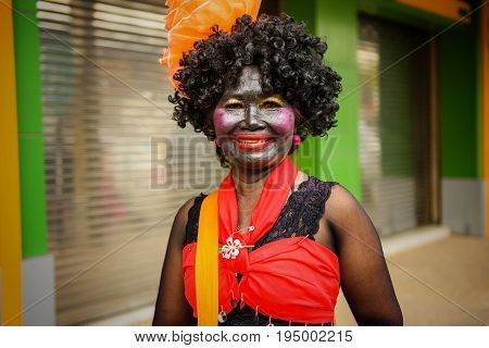 Woman With Funny Costume For Candle Festival