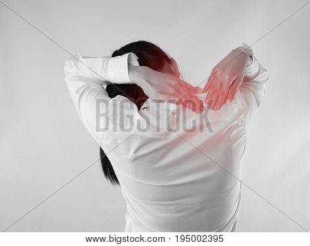 Young Asian woman touching back bone and having backache concept of office worker health care lifestyle. back view people.