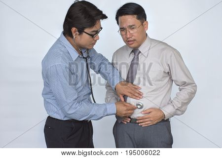 Doctor is checking patient, Asian Businessman stomachache/Male stomachache or Gastroenterologists / Concept with Healthcare And Medicine, isolated on white