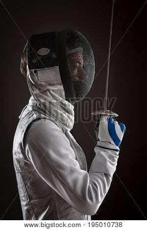 Woman Fencer With Mask Holding The Sword In Front Of Her