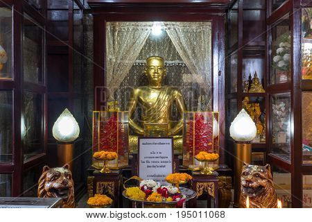 BANGKOK THAILAND - JULY 9 2017: A statue of King Taksin in Wat Intharam (Wat Bang Yi Ruea Nok). The Old Uposatha of Wat Bang Yi Ruea Nok Thonburi in Bangkok Thailand.