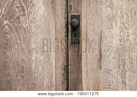 Rustic Vintage Door Knob On Antique Door Wood. Door Knob And Keyhole Made Of Brass On The Old Wooden