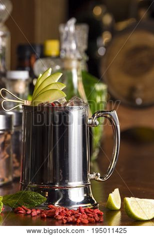 beer cocktail in stainles steel mug on the bar