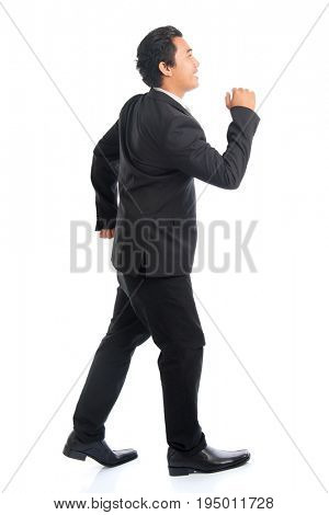 Full body side view young Southeast Asian businessman standby to run, isolated on white background.