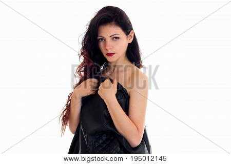 horizontal portrait of a beautiful brunette who looks into the camera, shielding her body jacket isolated on white background