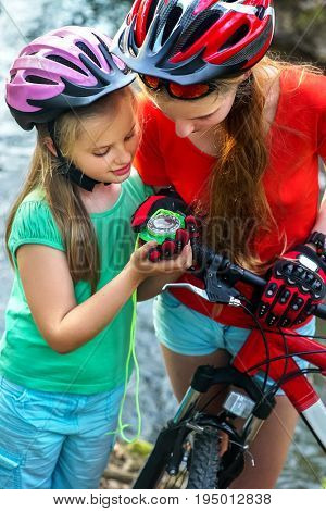 Bicycle compass in children hands. Cyclist look at device and looking for way. People lost their way traveling unaccompanied.