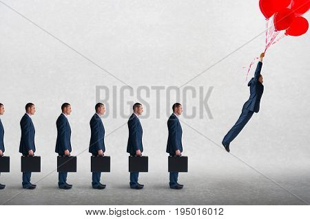 business success concept businessmen in a row businessman flying away with balloons