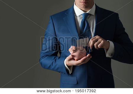 Stylish Formal Blue Suit And Piggy Bank