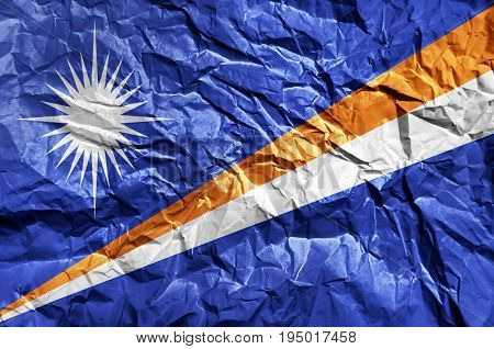 Marshall Islands flag painted on crumpled paper background