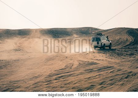Car Driving In Desert