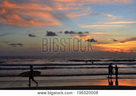 Surfer and sunset in Kuta Bali Indonesia (2015)