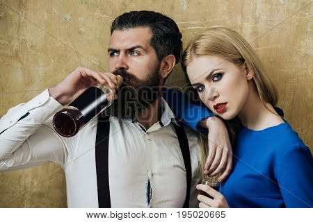 Hipster Drinking Wine From Bottle And Girl Holding Glass