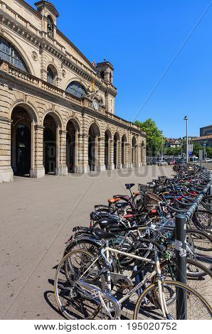Zurich, Switzerland - 18 June, 2017: facade of the Zurich main railway station, bicycles parked in front of it. Zurich main railway station is the largest railway station in Switzerland and one of the busiest railway stations in the world.