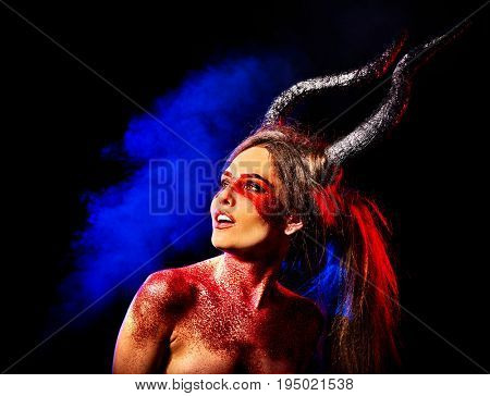 Mad satan woman on black magic ritual of hell. Witch reincarnation mythical creature Sabbath. . Zodiac Capricorn Aries. Make-up for night club for demon inflicts damage. Astral magic.