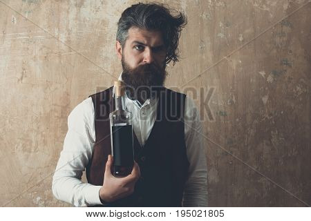 Man Holding Bottle Of Wine