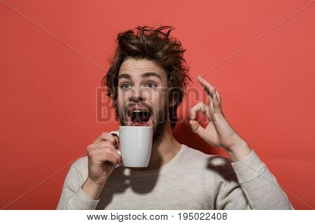 Ok Gesture Of Surprised Man With Cup Of Coffee